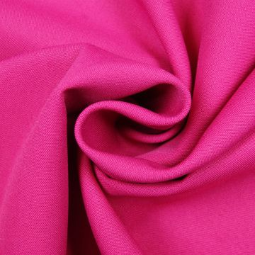 Texturé fuchsia 280cm breed brandvertragend + certificaat (30mtr)